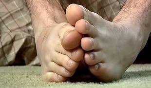 Straight boy Wiley cums on his own feet after a nice long cock stroking session