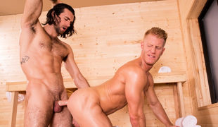 With beads of sweat across their chests, things are heating up with Woody Fox and Johnny V in the sauna